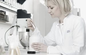 Female scientist is working in a laboratory.