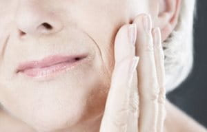 Signs of skin aging on face: deeper wrinkles