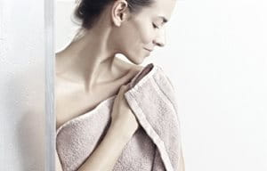 Woman wrapped in towel.