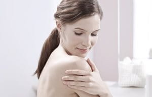 Woman applying Eucerin product on her hand